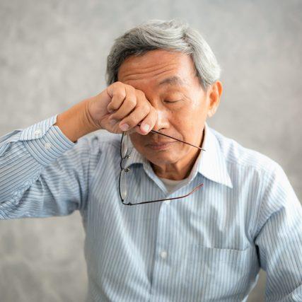 senior man suffering from dry eye