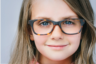 Eye exam, girl with eyeglasses in Akron, OH