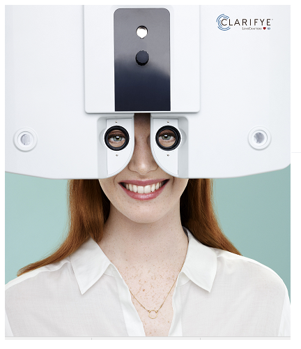Optometrist, woman using clarifye eye exam machine in Akron, OH