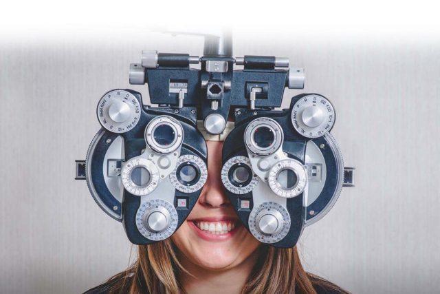 eye care, woman enjoying eye exam in Fort Worth, TX