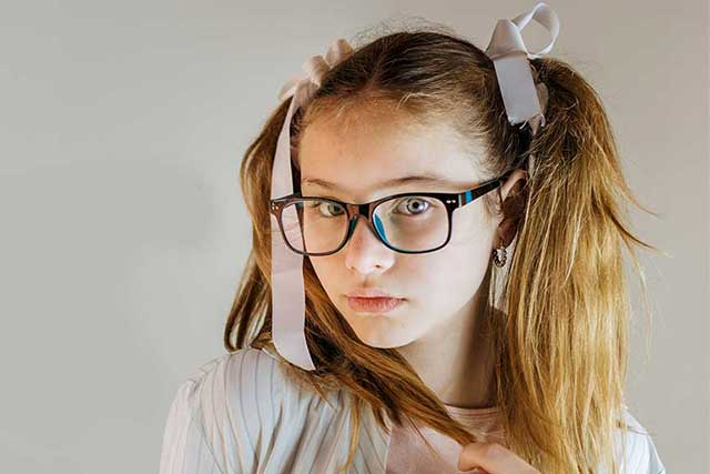 eye care, girl wearing glasses with myopia in Fort Worth, TX