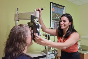Eye doctor giving an eye exam in Nashua, NH