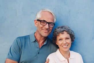 Senior husband and wife wearing eyeglasses