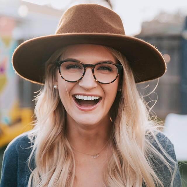 Woman wearing eyeglasses, brown hat