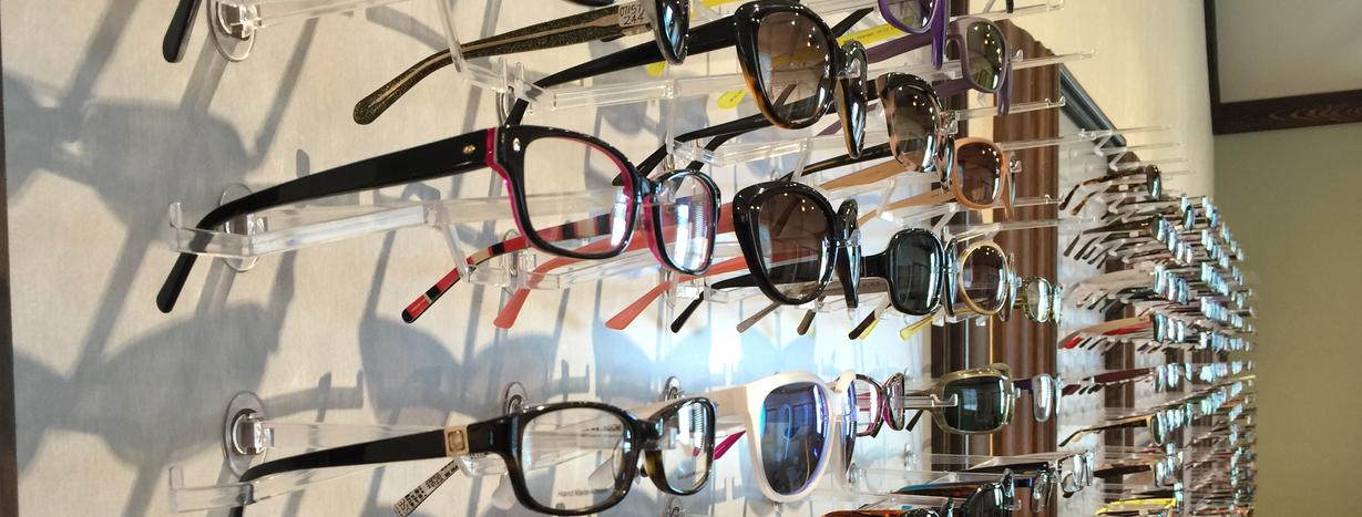 Eyeglasses displayed on wall