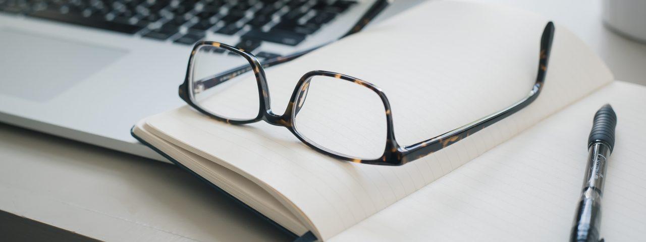 eyeglasses on top of book
