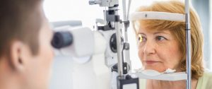 senior eye exam glaucoma amd istock 507115644