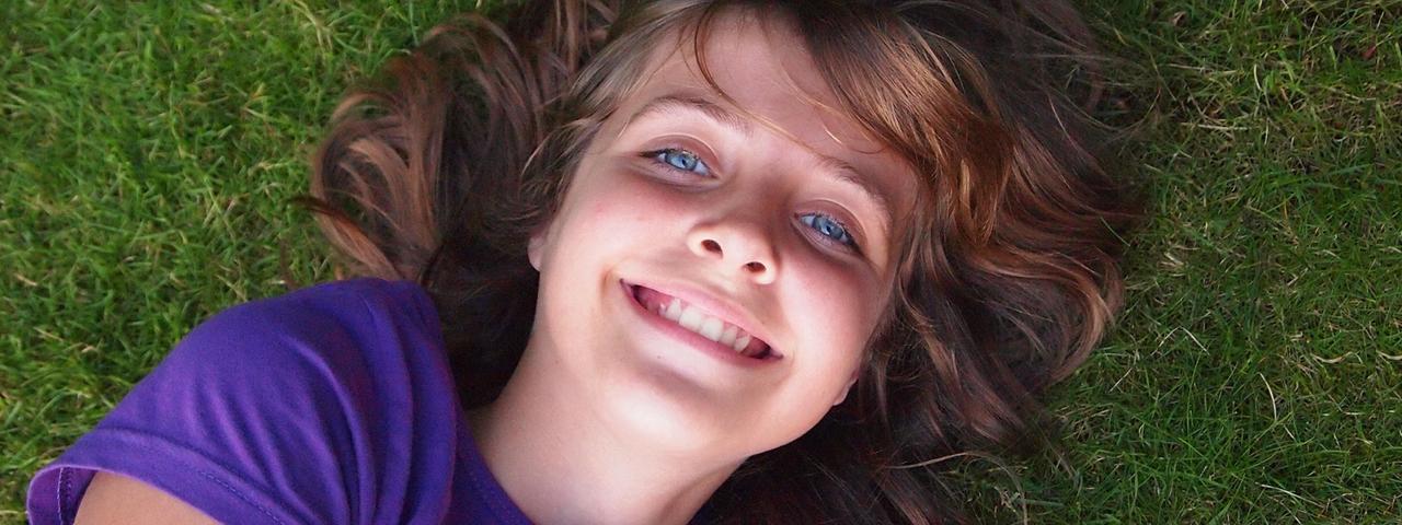 Happy Girl Laying Grass 1280x480