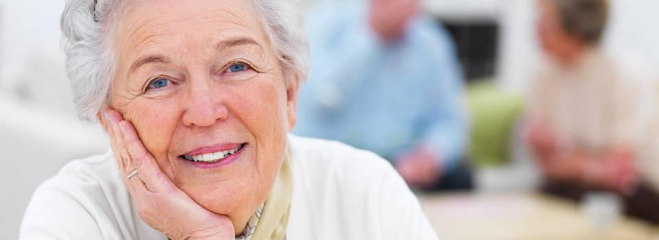 Eye doctor, senior lady smiling in Greenville, SC