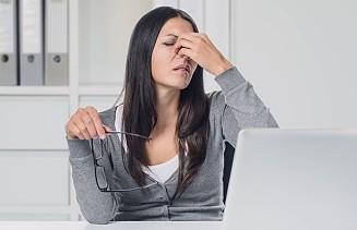woman suffering eye strain