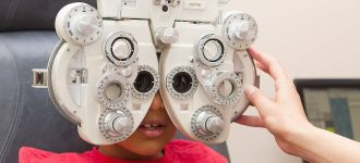 Eye exam, doctor examining patient in Piscataway, NJ