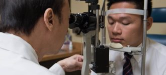 Eye exam, doctor examining patient in Edison, NJ